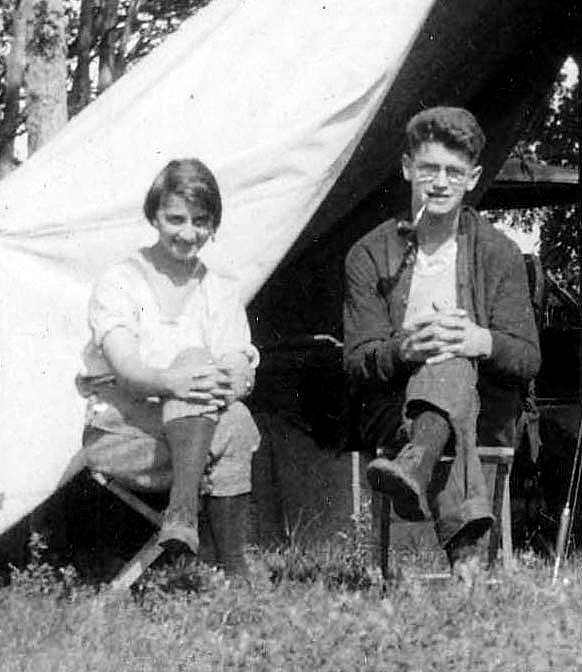 Carlton D. Fyler, and Jenny R. Fyler pose in front of tent while camping.